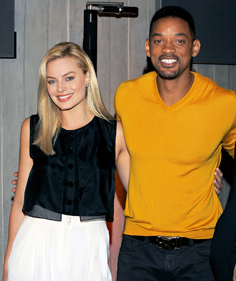 Margot Robbie and Will Smith attend a photocall and press conference for 'Focus' at El Zanjon on November 20, 2013 in Buenos Aires, Argentina