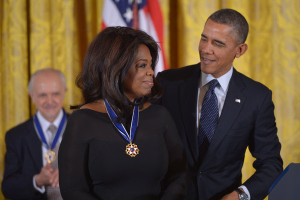 President Barack Obama presents the Presidential Medal of Freedom to broadcast journalist Oprah Winfrey during a ceremony in the East Room of the White House in Washington, DC.