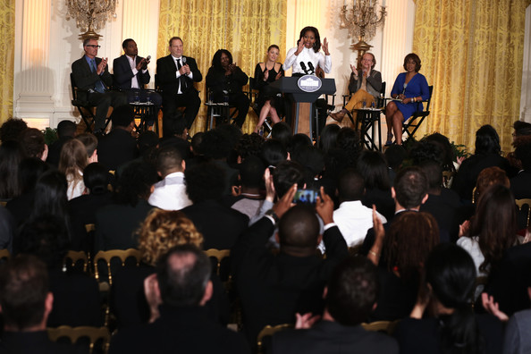 First Lady Michelle Obama speaks as (L-R) director David Frankel, director Ryan Coogler, production executive Harvey Weinstein, actress Whoopi Goldberg, actress Blake Lively, producer Bruce Cohen, and editor-at-large of The Oprah Magazine Gayle King listen during a workshop for high school students from DC, New York and Boston about careers in film production November 8, 2013 at the East Room of the White House in Washington, DC.