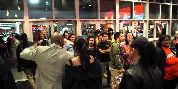 Morris Chestnut and family surprise moviegoers at Baldwin Hills-Crenshaw Plaza in L.A.
