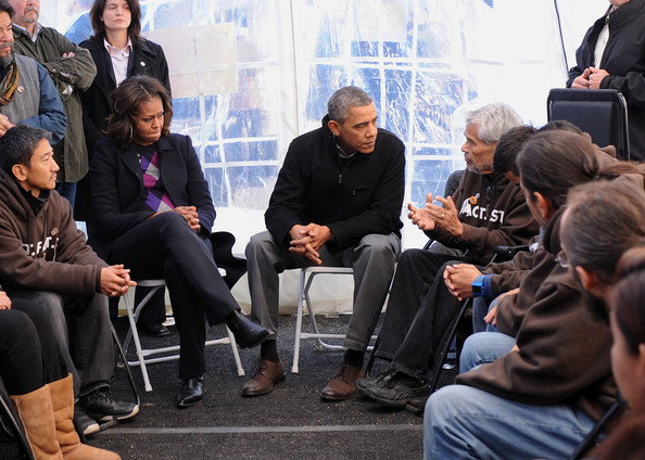 President Barack Obama (6th R) meets with people taking part in the Fast For Families on the National Mall in support of immigration reform as first Lady Michelle Obama (5th L) looks on November 29, 2013, in Washington, DC.