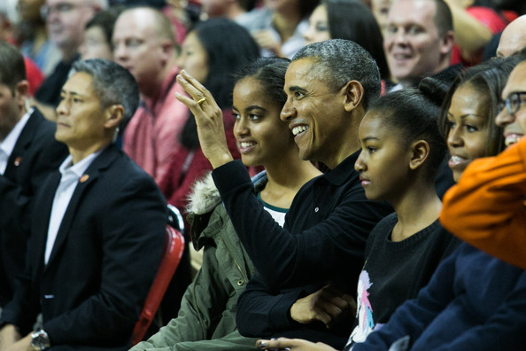 (L -R) Daughter Malia Obama, U.S. President Barack Obama, Sasha Obama and first lady Michelle Obama attend a men's NCCA basketball game between University of Maryland and Oregon State University, November 17, 2013 at Comcast Center in College Park, Maryland