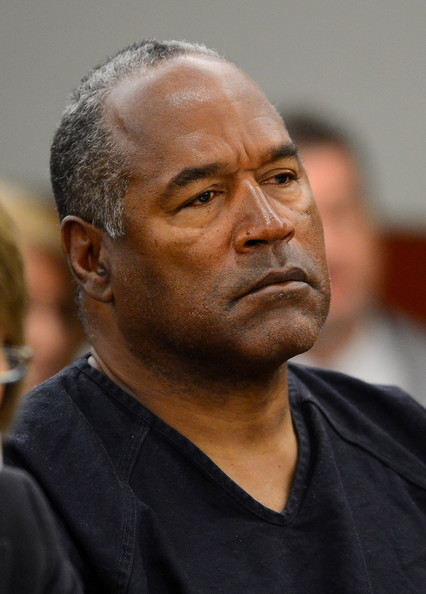O.J. Simpson watches his former defense attorney Yale Galanter testify during an evidentiary hearing in Clark County District Court on May 17, 2013 in Las Vegas