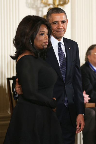 President Barack Obama (R) and Oprah Winfrey (L) on stage before Winfrey receives the Presidential Medal of Freedom in the East Room at the White House on November 20, 2013 in Washington, DC