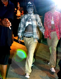 Rihanna and her passe dressed as chola zombies.