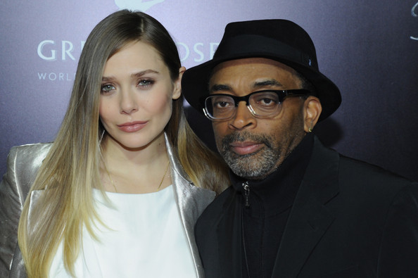 Actress Elizabeth Olsen and director Spike Lee attend the screening of 'Oldboy' hosted by FilmDistrict and Complex Media with the Cinema Society and Grey Goose at AMC Lincoln Square Theater on November 11, 2013 in New York City