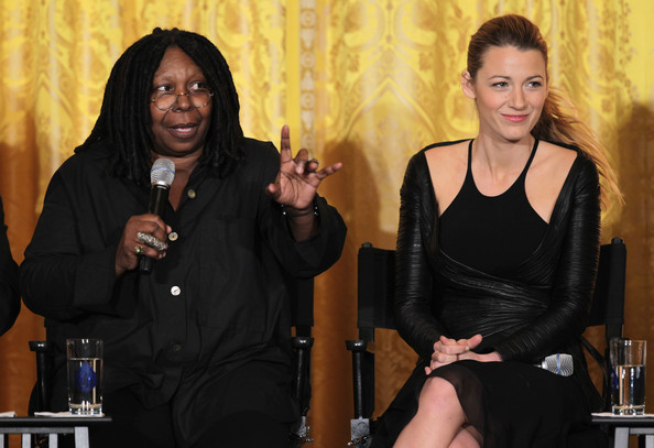 Actress Whoopi Goldberg (L) speaks as actress Blake Lively (R) listens during a workshop for high school students from DC, New York and Boston about careers in film production November 8, 2013 at the East Room of the White House in Washington, DC.