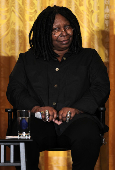 Actress Whoopi Goldberg listens during a workshop for high school students from DC, New York and Boston about careers in film production November 8, 2013 at the East Room of the White House in Washington, DC.
