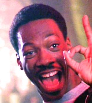 Eddie-Murphy-in-Beverly-Hills-Cop-1984-Movie-Image-e1346207670507
