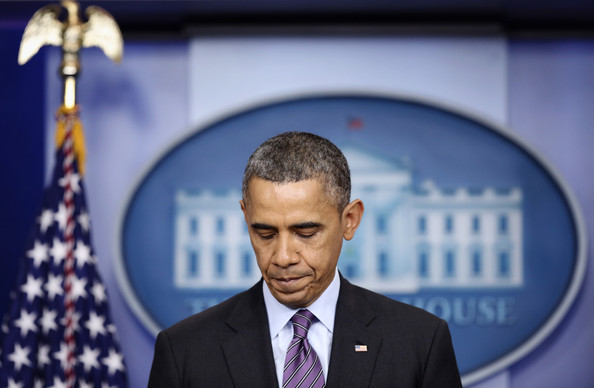 President Barack Obama pauses as he makes a statement regarding the death of former South African president Nelson Mandela at the James Brady Press Briefing Room of the White House December 5, 2013 in Washington, DC.