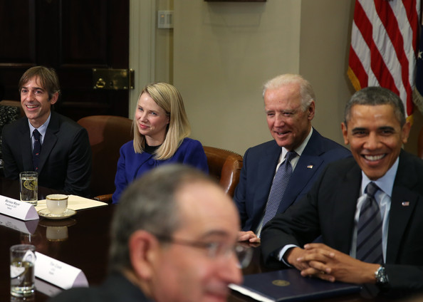U.S. President Barack Obama (R), with Vice President Joseph Biden (2ndR), meet with Yahoo CEO Marissa Mayer (2nd-L) and Zynga CEO Mark Pincus (L), and other executives from leading technology companies, including Apple, Twitter, and Google in the Roosevelt Room of the White House on December 17, 2913 in Washington, DC.