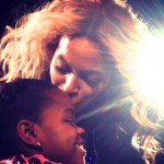 Madonna's Daughter Gets a Smooch from Beyonce on Stage (Pic)