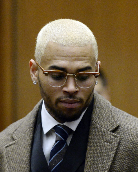 Chris Brown appears in court for a probation violation hearing during which his probation was revoked by a Los Angeles Superior judge on December 16, 2013 in Los Angeles