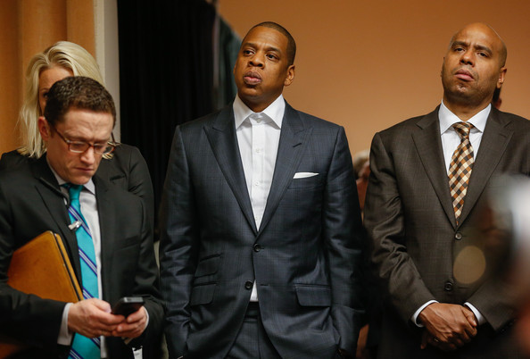 Jay Z (C), agent for Robinson Cano of the Seattle Mariners, looks on during a press conference introducing Cano to the media at Safeco Field on December 12, 2013 in Seattle, Washington