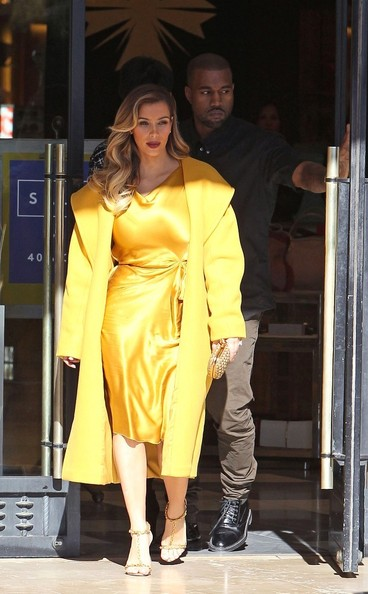 Kim Kardashian wears bright yellow as she gets ready to shop in New York City with Kanye West and mom Kris Jenner on December 11, 2013