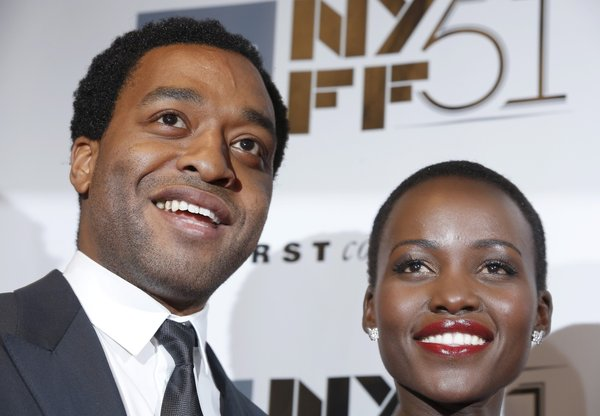 "Actor Chiwetel Ejiofor (L) and actress Lupita Nyong'o attend the ""12 Years A Slave"" premiere during the 51st New York Film Festival at Alice Tully Hall at Lincoln Center on October 8, 2013 in New York City."
