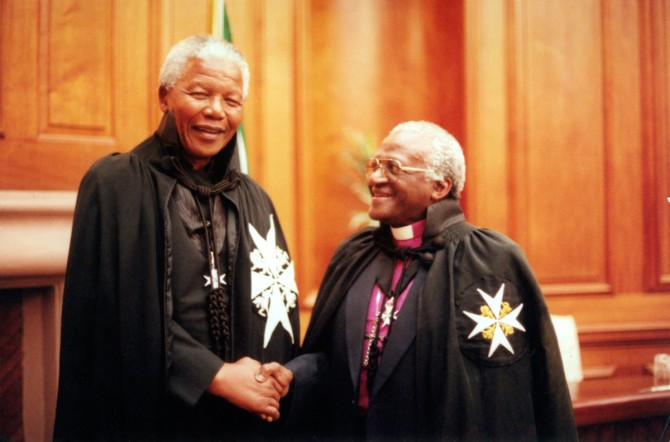 Two South African Nobel laureates greeting each other, President Nelson Mandela and Archbishop Desmond Tutu