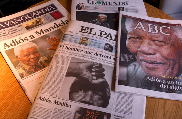 Spanish national newspapers all feature the death of former South African president Nelson Mandela on their front page at a coffee shop on December 6, 2013 in Madrid, Spain.