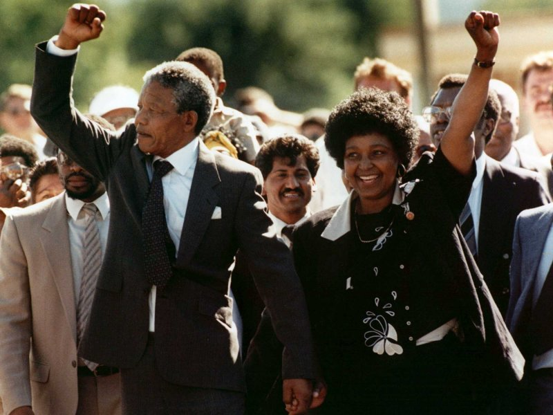 Nelson Mandela and wife Winnie, walking hand in hand, raise clenched fists upon his release from Victor prison, Cape Town, Sunday, February 11, 1990
