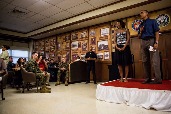 President Barack Obama and First Lady Michelle Obama make their annual trip to speak with current and retired members of the U.S. military and their families as they eat a Christmas Day meal in the Anderson Hall mess hall at Marine Corps Base Hawaii on December 25, 2013 in Kaneohe Bay, Hawaii