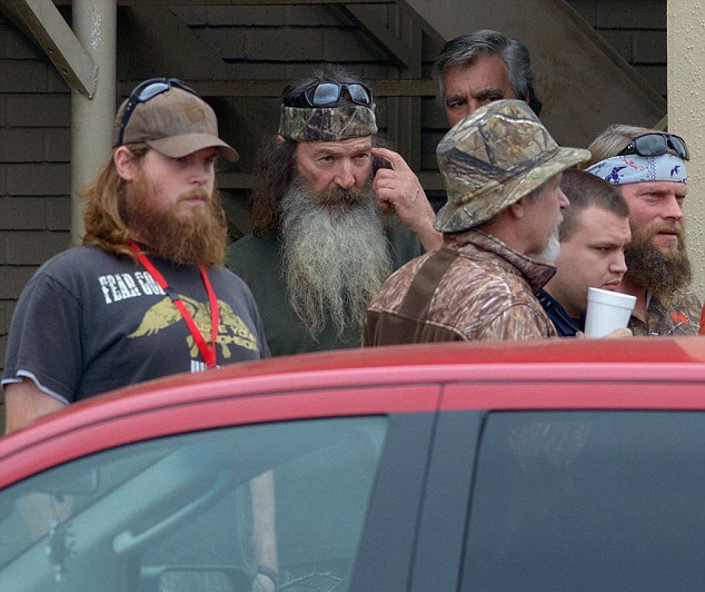 Phil Robertson (center), patriarch of the Duck Dynasty family, leaves church in Louisiana with his family in West Monroe, La (Dec. 22, 2013)