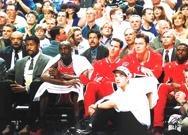Preston Truman (seated) in front of the Bulls bench