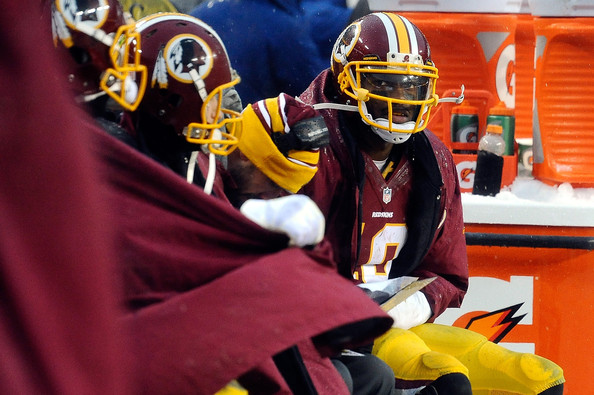 Quarterback Robert Griffin III #10 of the Washington Redskins sits on the bench in the fourth quarter during an NFL game against the Kansas City Chiefs at FedExField on December 8, 2013 in Landover, Maryland