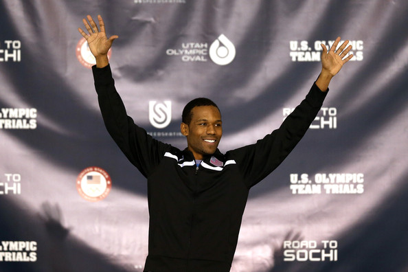 Shani Davis celebrates on the medals podium after winning the men's 1,000 meter during the U.S. Speed Skating Long Track Olympic Trials at the Utah Olympic Oval on December 29, 2013 in Salt Lake City, Utah