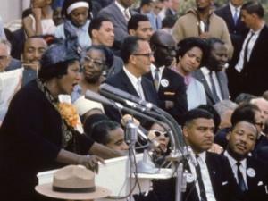 Mahalia Jackson sings as Dr. King (lower right) listens