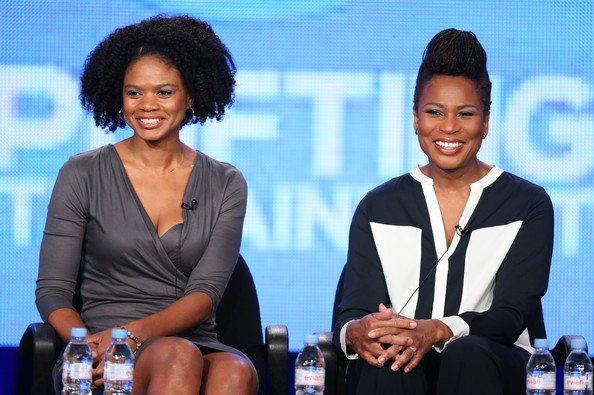 Actress Kimberly Elise and Angela Logan peak onstage during the 'Apple Mortgage Cake' panel discussion at the UP portion of the 2014 Winter Television Critics Association tour at the Langham Hotel on January 11, 2014 in Pasadena, California