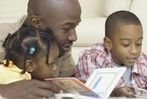 black father reading to kids