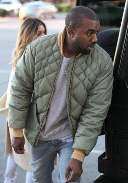 Couple Kim Kardashian and Kanye West out doing some shopping at a sporting goods store in Los Angeles, California on December 26, 2013