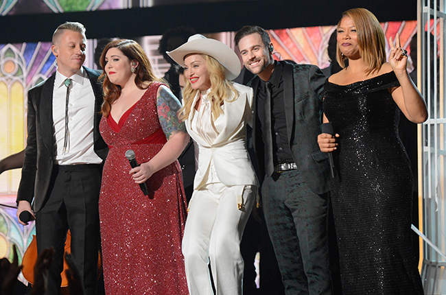 (L-R) Rapper Macklemore, singers Mary Lambert and Madonna, musicians Ryan Lewis and Queen Latifah perform onstage during the 56th GRAMMY Awards at Staples Center on January 26, 2014 in Los Angeles, California