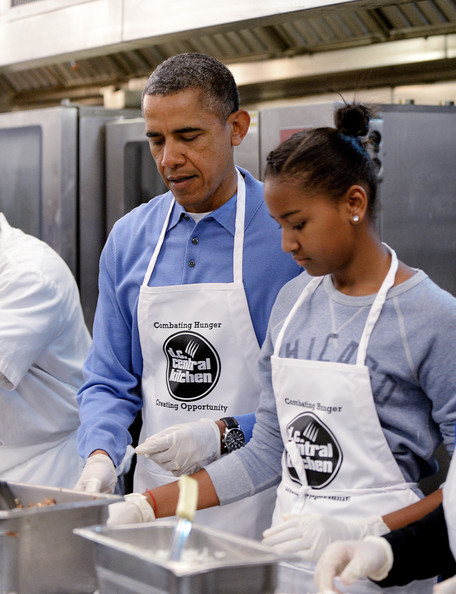 U.S. President Barack Obama with daughter Sasha participate in a community service project at the D.C Central Kitchen in celebration of the Martin Luther King, Jr. Day of Service and in honor of Dr. King's life and legacy on January 20, 2014 in Washington, DC. Americans honor the birth of civil rights leader Martin Luther King, Jr.