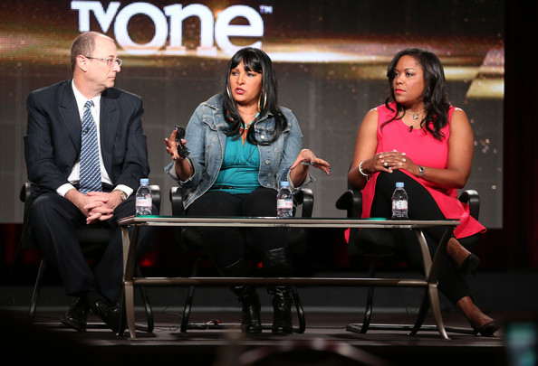 (L-R) Frank Sinton, Executive Producer, actress Pam Grier and D'Angela Proctor, SVP Programming and Production, TV One, speak onstage during the 'Unsung Hollywood' panel discussion of the TV One portion of the 2014 Winter Television Critics Association tour at the Langham Hotel on January 9, 2014 in Pasadena, California