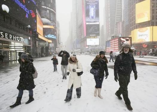 people walking in snow (times square)