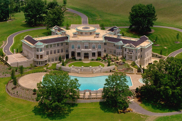 Why rick ross really bought evander holyfield s mega for Biggest house in usa