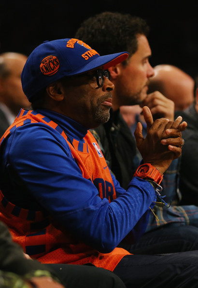 Director Spike Lee cheers on the New York Knicks during their game against the Brooklyn Nets at the Barclays Center on December 5, 2013 in the Brooklyn borough of New York City