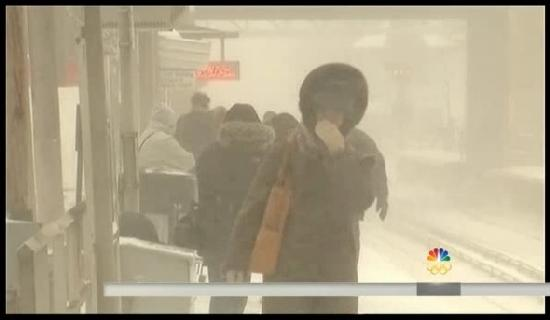 woman walking in blowing snow (polar vortex)