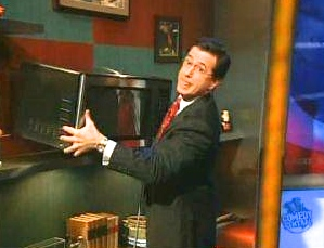 """Stephen Colbert stealing the microwave oven from the green room of Fox News Channel's """"The O'Reilly Factor' in 2007"""