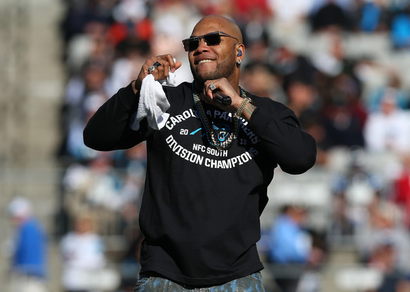Rapper Flo Rida performs at halftime during the NFC Divisional Playoff Game between the San Francisco 49ers and Carolina Panthers at Bank of America Stadium on January 12, 2014 in Charlotte, North Carolina