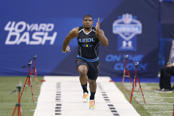 Former Missouri defensive lineman Michael Sam runs the 40-yard dash during the 2014 NFL Combine at Lucas Oil Stadium on February 24, 2014 in Indianapolis, Indiana