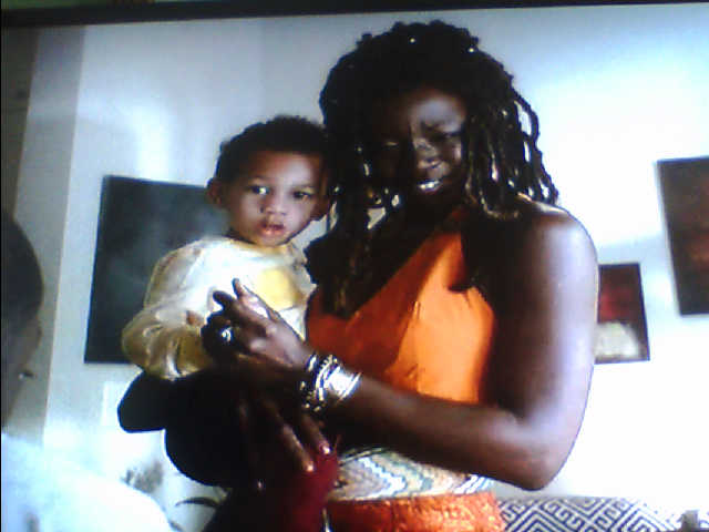 "MIchonne and her son in a flashback on AMC's ""The Walking Dead"""