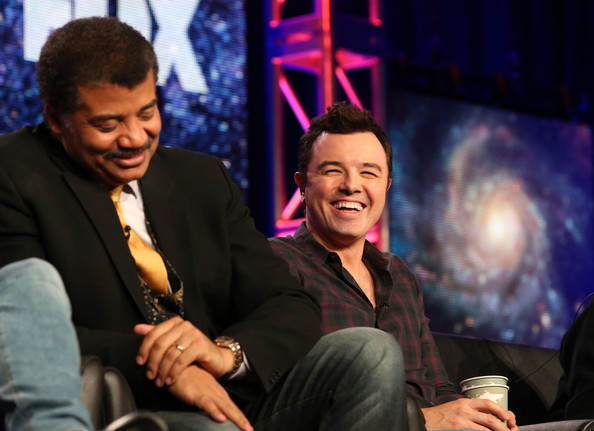 Neil DeGrasse Tyson (L) and executive producer Seth MacFarlane speak during the FOX portion of the 2014 Television Critics Association Press Tour at the Langham Hotel on January 13, 2014 in Pasadena, California