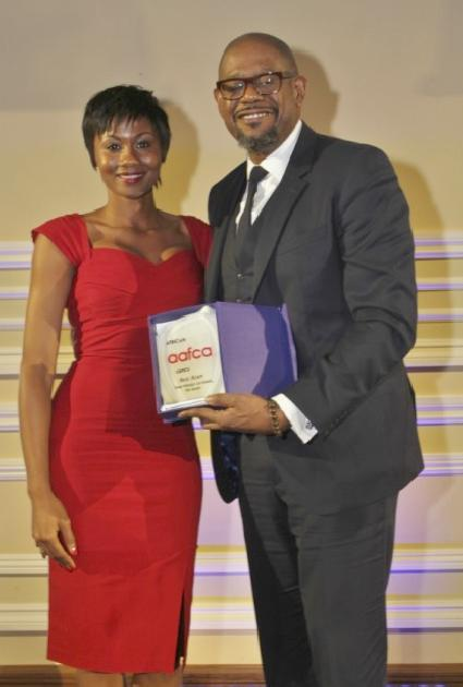 Actress Emayatzy Corinealdi with AAFCA Best Actor Forest Whitaker