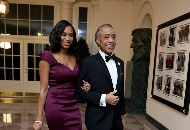 Al Sharpton and Aisha McShaw arrive for a State Dinner in honor of French President François Hollande, at the White House in Washington, Tuesday, Feb. 11, 2014
