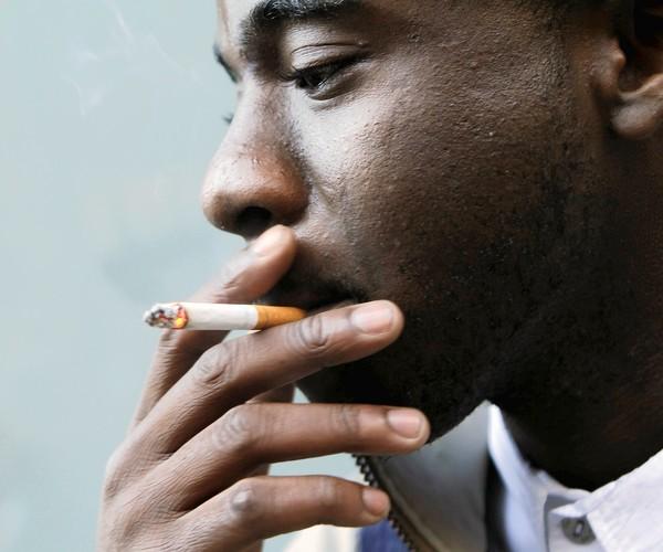 black man smoking cigarette