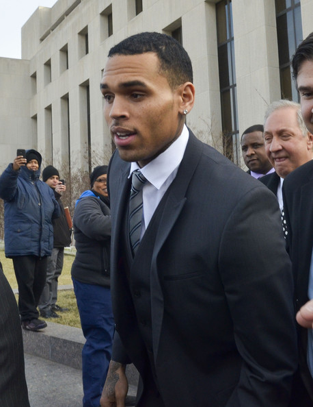 Chris Brown (C) leaves court where his attorneys rejected a plea deal that would have found him and his bodyguard guilty of simple assault on January 8, 2014 in Washington, DC.
