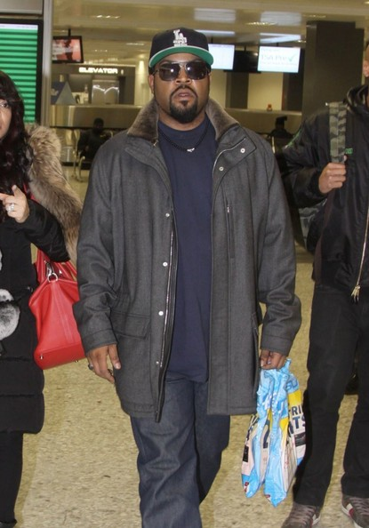 Actor/rapper Ice Cube arrives on a flight at Washington Dulles International Airport in Sterling, Virginia on February 7, 2014. Ice Cube is in town to accept a BET honors award