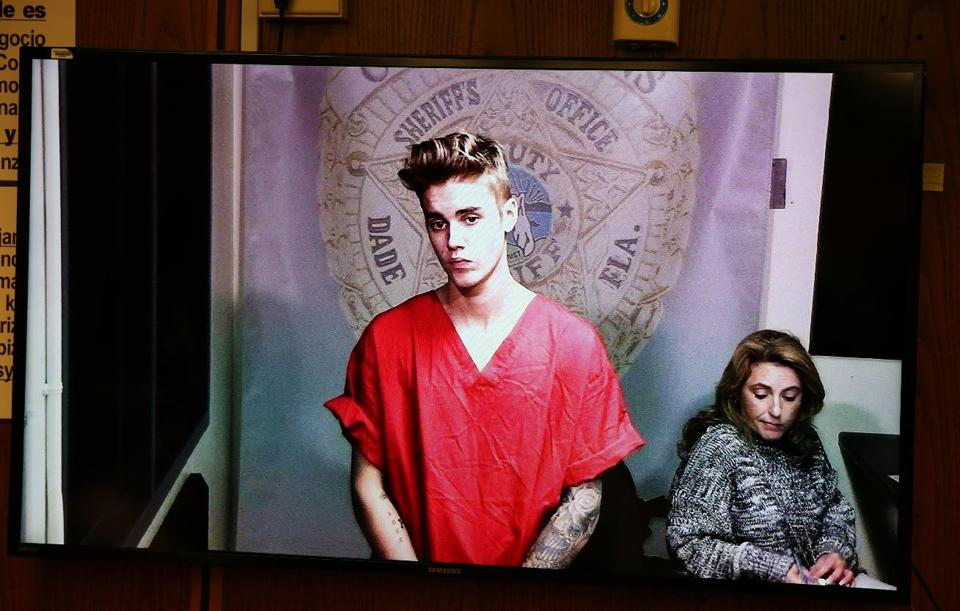 Jan. 23, 2014, file photo shows Justin Bieber appearing in court via video feed in Miami.